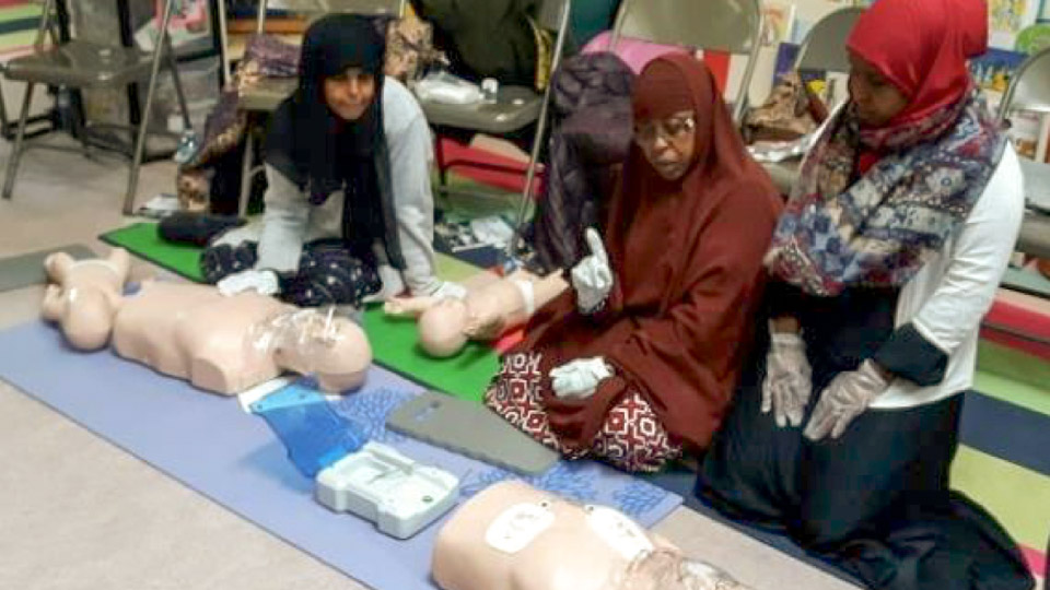 Three women learning CPR