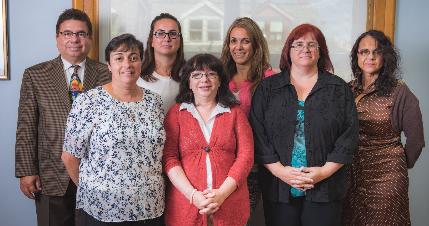 The NCCS Home Child Care Team posing for a photo. Six women and one man.