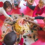A group of children building a craft volcano